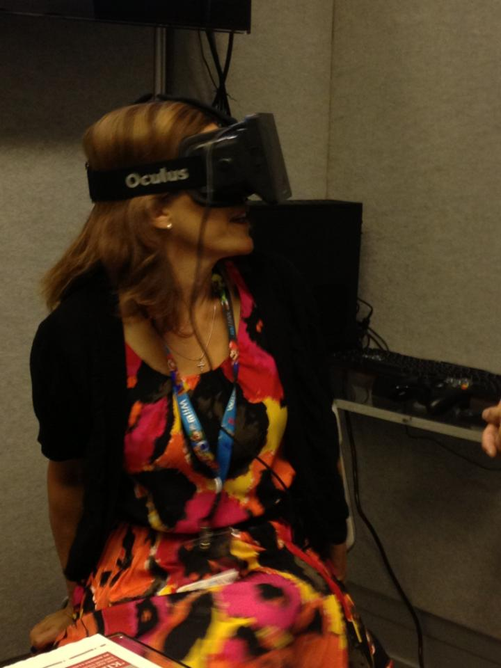 Lisa Cosmas Hanson tries out the Oculus Rift VR headset at E3 2013